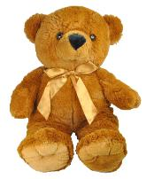 plush brown bear with gold ribbon